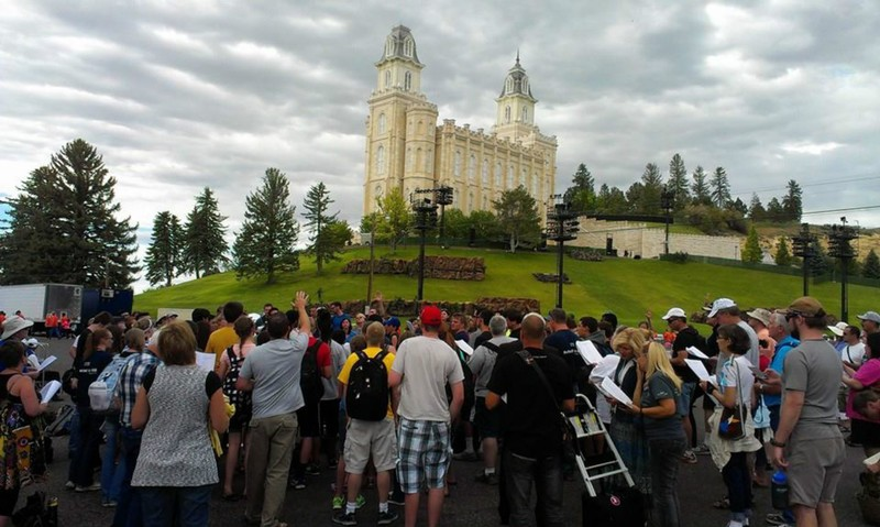 Christian evangelists gather to sing and pray prior to evangelizing