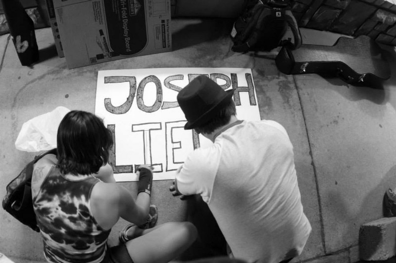 Missionaries making their own JosephLied.com signs