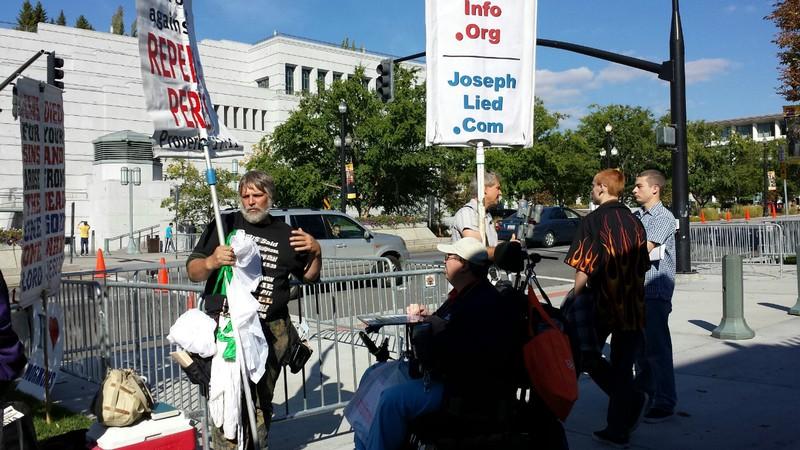 Rob talking to 2 agnostics outside Temple Square