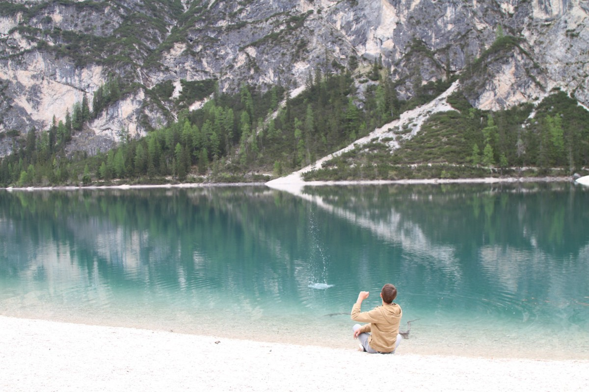 Skipping rocks at Pragersee Lake in the Dolomites.
