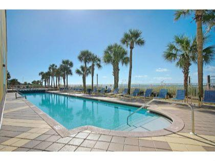 TWO LARGE POOLS JUST STEPS FROM THE SANDY BEACHES.