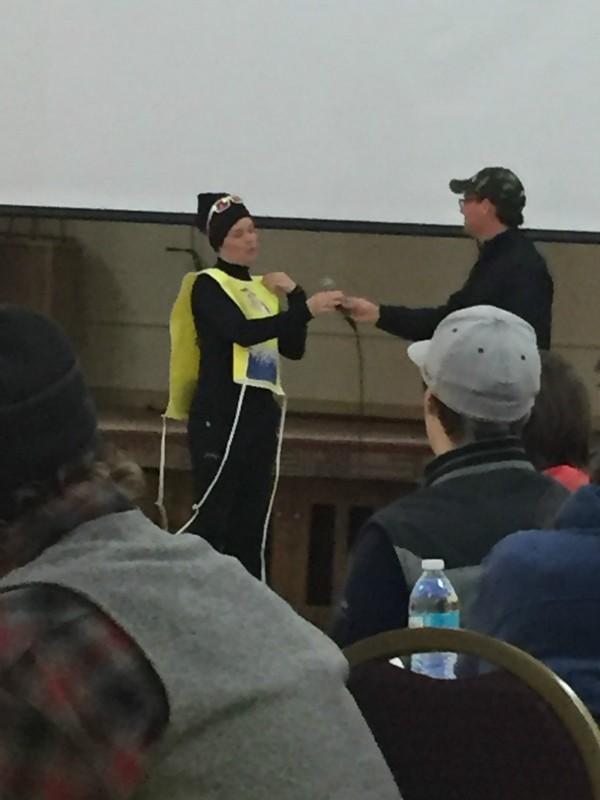 Lina Streeper receiving the Yellow Bib.