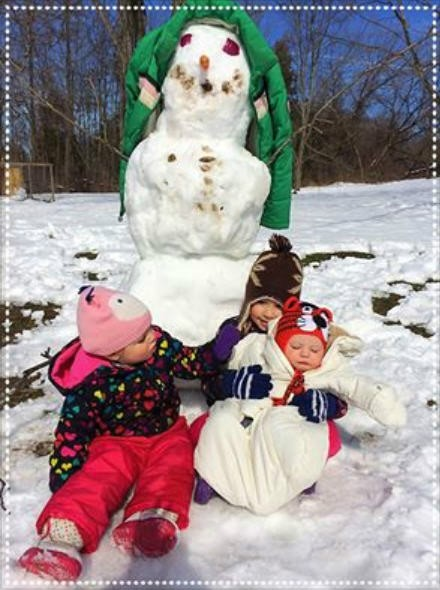 It's really impossible to get them all looking. But it's a snowman. Oh and my coat is her hair.....Dawn Garceau