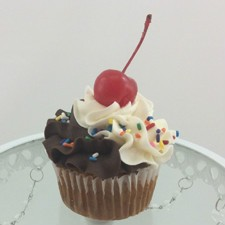Banana Split cupcake!  Banana cake filled with strawberry filling, iced with our choclate and wippy dip icing and topped with rainbow jimmies and a cherry!