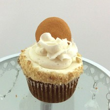 Banana Cupcake with wippy dip icing, rolled in vanilla wafer crumbles and topped with a full wafer cookie.