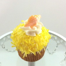 Pina Colada cupcake! Pineapple cupcake topped with wippy dip and rolled in coconut.