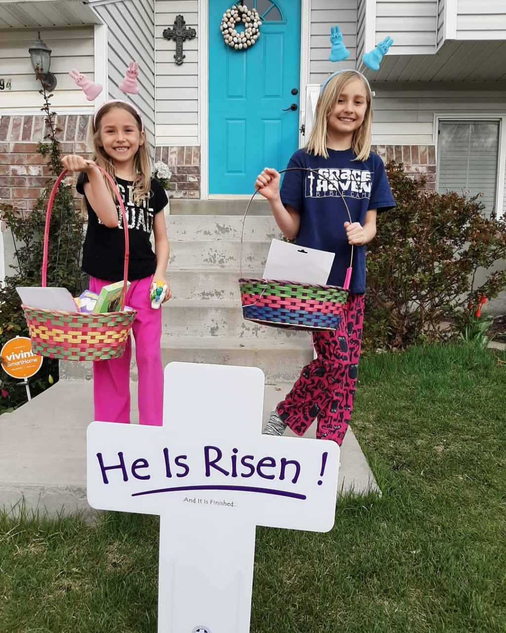 Zoe and Charis with our Easter sign