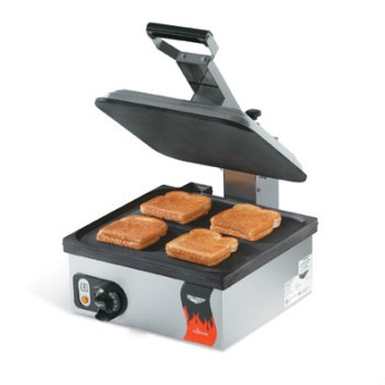 Cayenne sandwich press by Vollrath, model 40792. Electric with flat plate and non-stick finish. Single, 13 x 14 fixed cast aluminum flat lower grill. Adjustable hinged upper grill with flat plate, non-stick coating on both plates. Thermostatic controls, stainless steel housing.