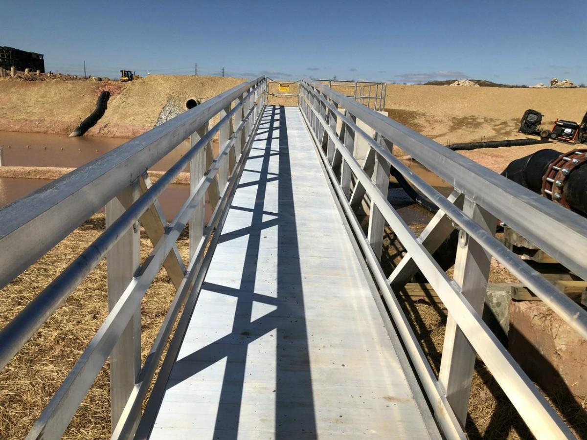 Temporary Utility Pedestrain Bridge for Cox's Creek Treatment Plan