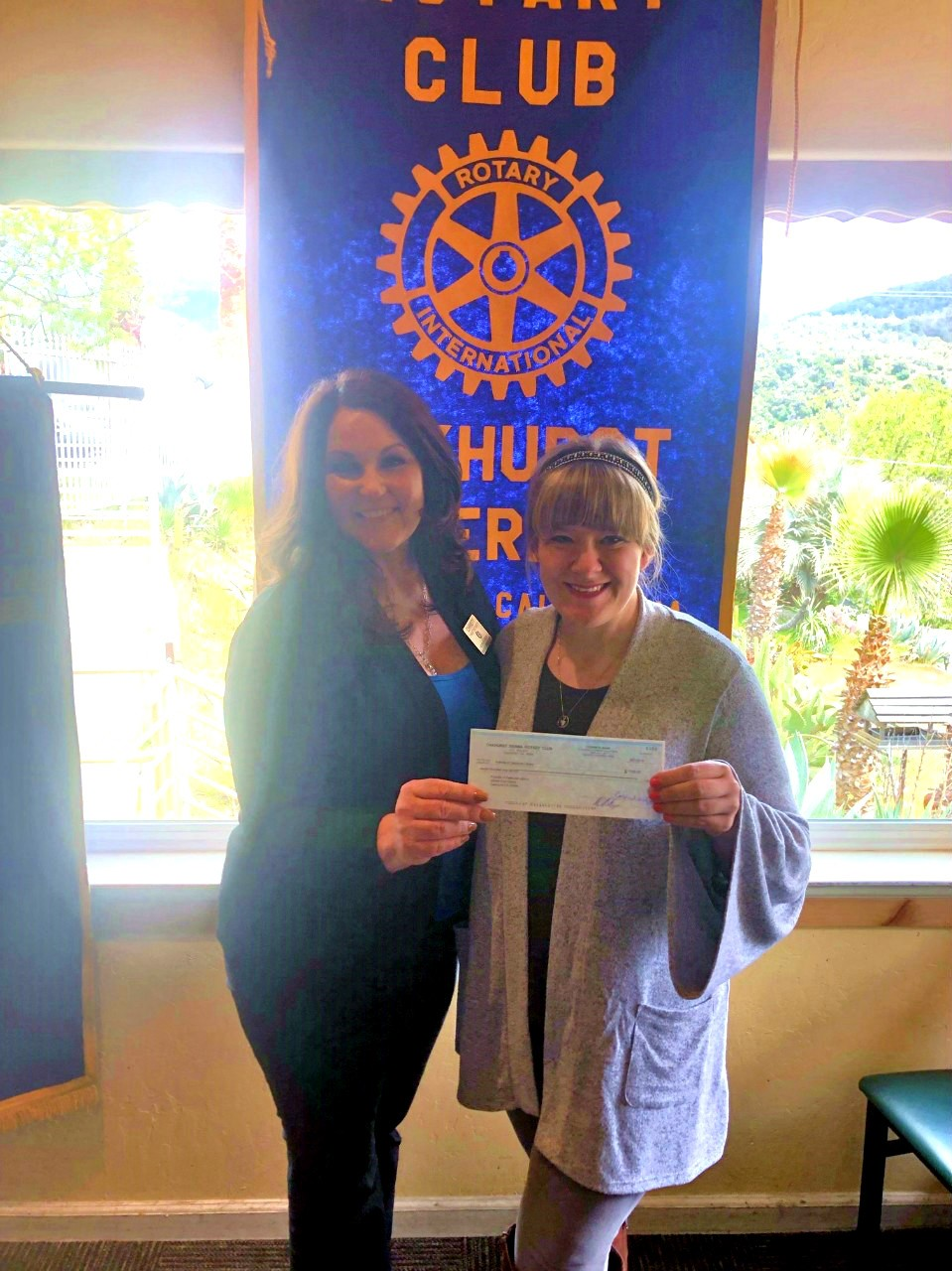 SIERRA ROTARY PRESIDENT-ELECT CHRISTY SMITH PRESENTS SUMMER ART SPONSORSHIP CHECK FOR $700 TO LEILANI CUMMINGS OF OAKHURST BRANCH LIBRARY